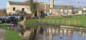 Reflection of Micklethwaite Bridge on Leeds and Liverpool Canal