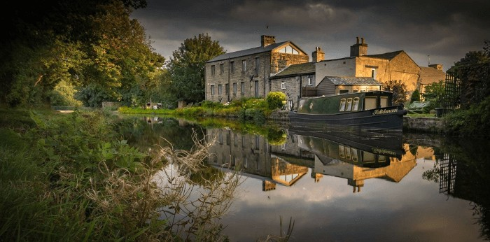 Reflection of a barge in Leeds and Liverpool canal at Dowley Gap near Bingley