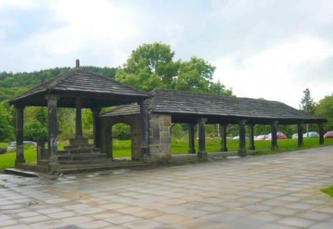 View of the old cover market and stone Buttercross on Market Square, Bingley