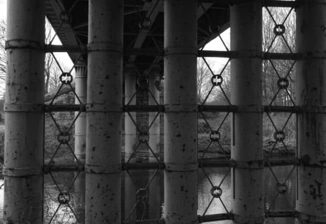Steel Bridge pillars above River Aire near Hirst Wood - Leeds to Morecombe Railway Line