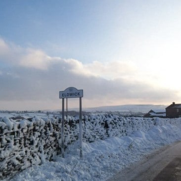 Eldwick sign in Snow
