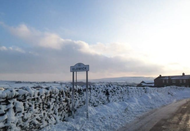 Snow covered sign of Eldwick