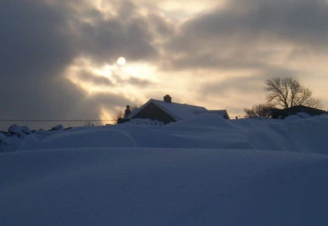 Snow Covered House in Eldwick with Sun Peeking through the Morning Clouds