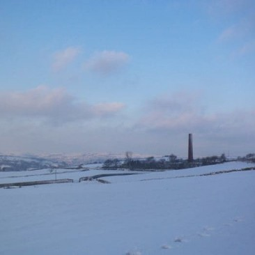 Rombalds Moors in Snow from Eldwick with Chimney in the Landscape