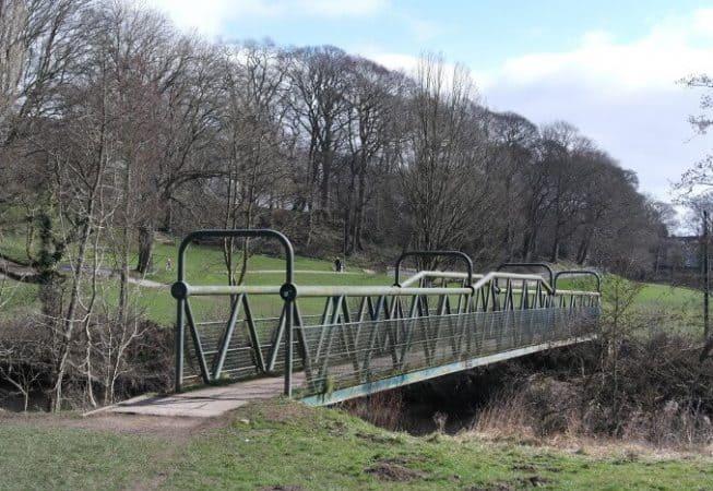 Festival of Britain tubular bridge in Myrtle Park above the River Aire