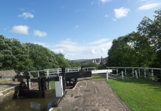 View of the top lock gate at Bingley Five Rise with the Damart Mill in the background