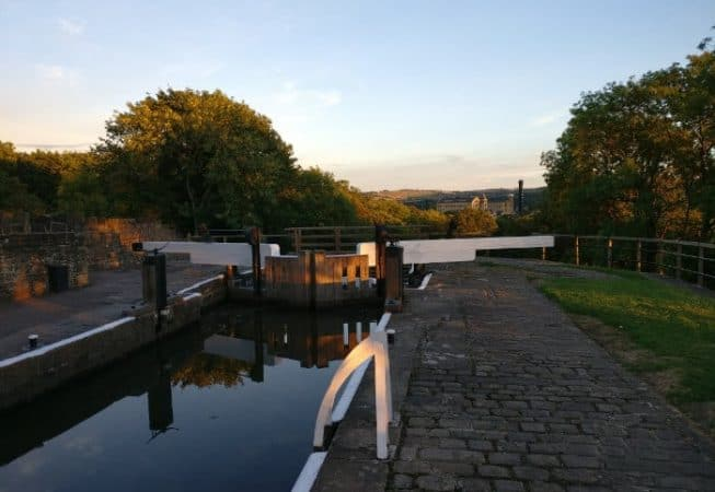 Sunset picture of top of Five Rise Locks with Damart Mill in the background