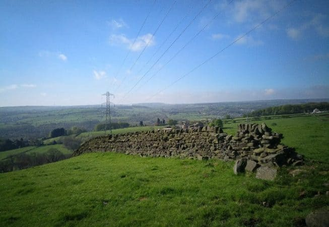 Stone wall and electric line in the Harden Valley with Cullingworth in the background