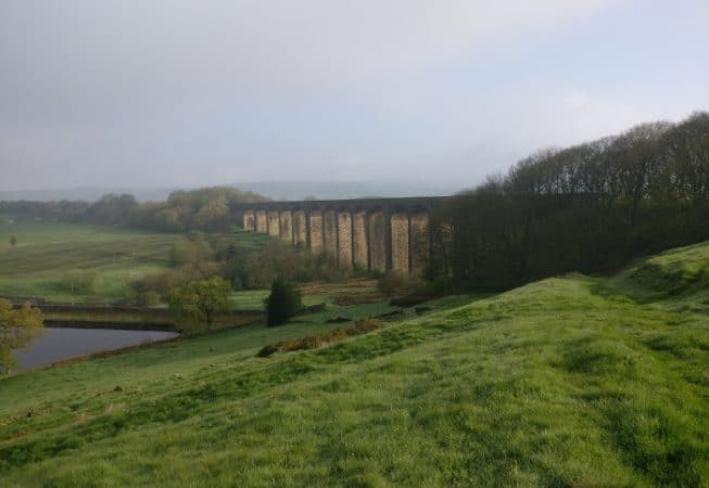 Early morning view of both Hewenden Viaduct and Reservoir