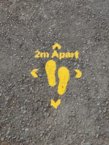 stencil about social distance stay 2m apart