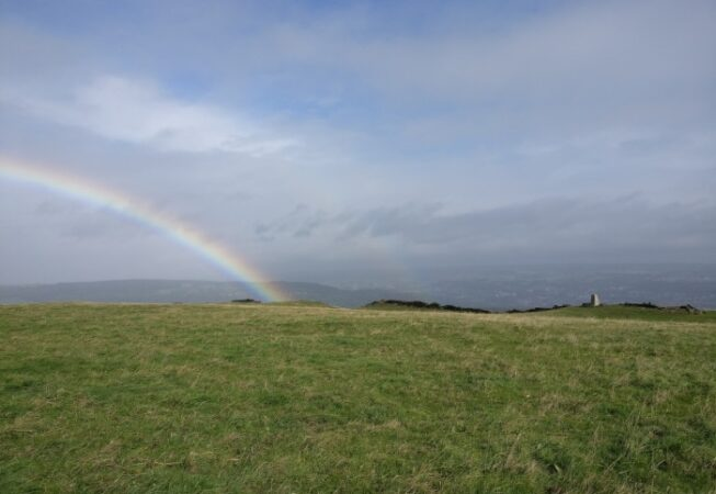 Rainbow on top of Norr Hill with trig point